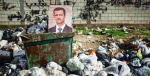 A picture of Assad sits in a dumpster in Syria. Turkey's president wants to ensure the Kurds do not get their own state in northern Syria. Photo Credit: Flickr (Freedom House) Creative Commons.