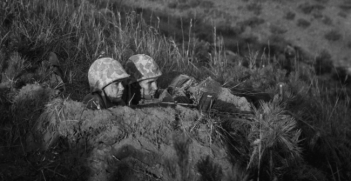 Two soldiers in a foxhole during the Korean war. Photo Credit: Flickr (Morning Calm Weekly Newspaper) Creative Commons.