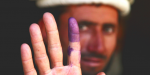 A man votes in Afghanistan  - Democracy is in retreat around the world. Photo Credit: Flickr (US Army Garrison - Miami) Creative Commons.