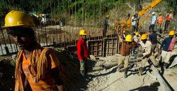 Construction workers in Dagachhu Hydropower Development in Bhutan. Photo Credit: Flickr (Asian Development Bank) Creative Commons.