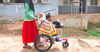 Afiya is pushed by her mother is Sarah in Uganda, in one the donated Wheelchairs.Photo Credit: World Vision Uganda (Simon Peter Esaku/World Vision Uganda) Copyrighted.