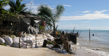 Households on South Tarawa do not have the option to retreat from coastal erosion, as the atoll is narrow and already crowded. Photo Source: Wikipedia (South Tarawa) Creative Commons