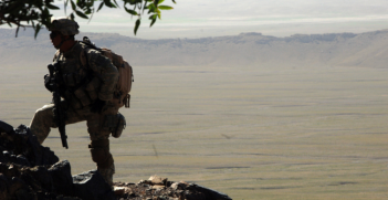 A U.S. Army Soldier from 2nd Battalion, 508th Parachute Infantry Regiment searches the mountains of the Andar province of Afghanistan for Taliban members and weapons caches June 6, 2007. Photo Source: (Flickr) The U.S. Army. Creative Commons.