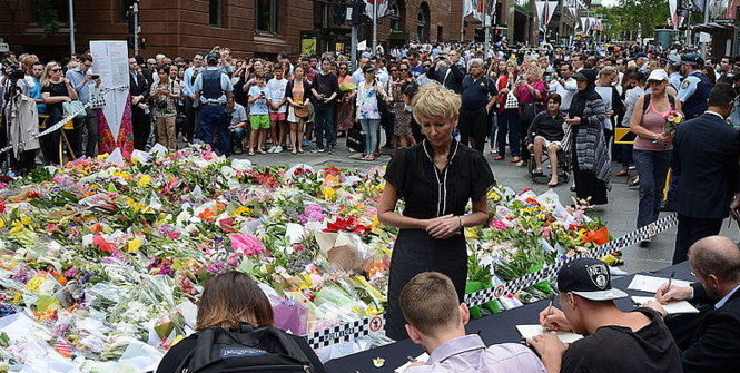 People signing condolences books after Lindt Café siege, Martin Place, Sydney, 2014-12-16. Photo Source: Wikimedia Commons. Creative Commons.
