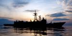 HMAS DARWIN at sunset in the South China Sea sailing off the coast of Pulau Tioman during Exercise Bersama Lima 2009. Photo Source: Royal Australian Navy (Flickr). Creative Commons