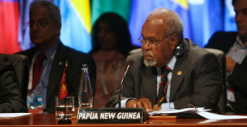 Papua New Guinea PM Sir Michael Somare follows proceedings at CHOGM 2009. Photo Source: The Commonwealth (Flickr). Creative Commons.