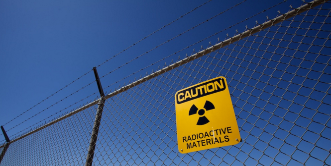 Warning at Trinity site. Photo Source: Charles (Flickr). Creative Commons.