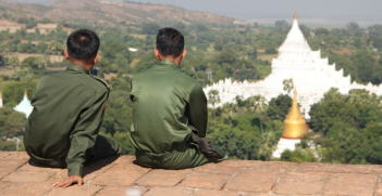 Burmese soldiers look out over a temple. Photo Credit: McLac2000 (Pixabay). Public Domain.