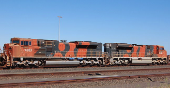 A loaded BHP train at Nelson Point yard, Port Hedland, WA. Photo source: Bahnfrend (Wikimedia). Creative Commons.