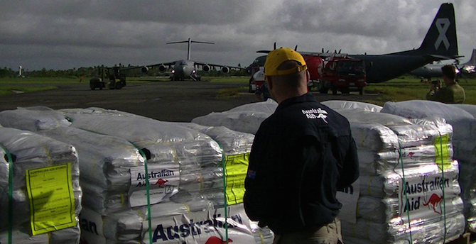 Australian aid humanitarian supplies being loaded up. Photo source: DFAT (Flickr). Creative Commons.