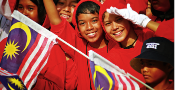 Young Malaysians commemorate the country's federation. Photo source: Ishak J (Flickr). Creative Commons.