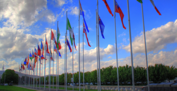 Flags representing all the diplomatic missions in Canberra. Photo source: Prescott Pym (Flickr).