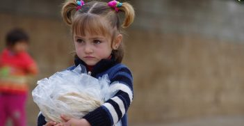 Bread distribution inside Syria. Photo credit: IHH Humanitarian Relief Foundation Follow (Flickr) Creative Commons