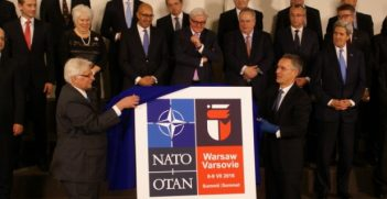 NATO Summit Warsaw 2016 logo unveiled. Photo credit: Ministry of Foreign Affairs Republic of Poland (Creative Commons)