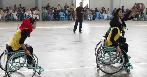 Caption: In April 2016, the ICRC organised a wheelchair basketball tournament at the organisation's orthopaedic centre in Kabul. Afghanistan's four female wheelchair basketball teams competed, Mazar-e-Sharif, Kabul, Jalalabad and Herat. In this match Kabul (yellow) is playing Jalalabad (green). Mazar-e-Sharif won the tournamen. Photo copyright: Olivier Moeckli/ICRC