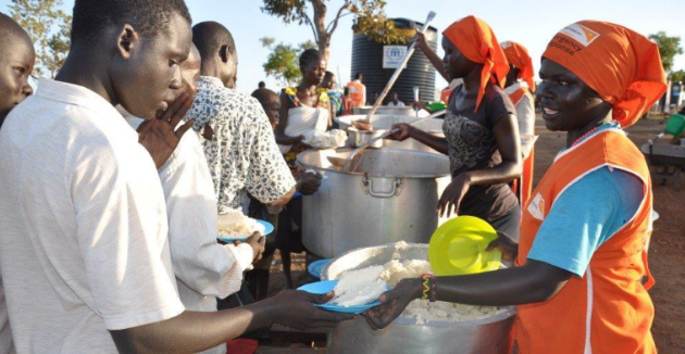 Rations being distributed in Uganda. Photo: Moses Mukitale, World Vision.