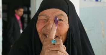 Female voters display their purple finger tips after casting ballots at an elementary school in Nasiriyah March 7. By law, women must fill 25percent -- 82 out of the 325 -- parliamentary seats. The heavy purple dye reduces attempts of double-voting fraud. No election day violence occurred in Nasiriyah, Iraq's fourth largest city bisected by the Euphrates River in the southern province of Dhi Qar. Iraqi security forces were responsible for all security.
