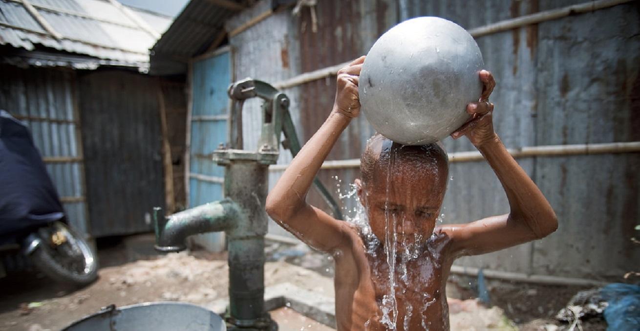 A child washes himself in Kallayanpur, a slum in Bangladesh's capital, Dhaka.