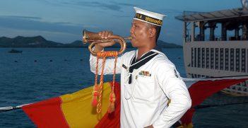 A Royal Thai Navy bugler aboard HTMS Phutthayotfa Chulalok