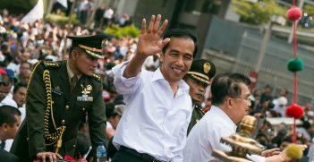 President Jokowi waves to a crowd in Jakarta