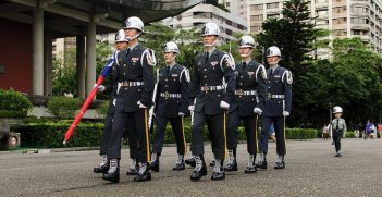 Taiwanese soldiers are joined by a child
