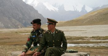 Chinese and Pakistani border guards overlook the remote Khunjerab Pass which connects the two countries