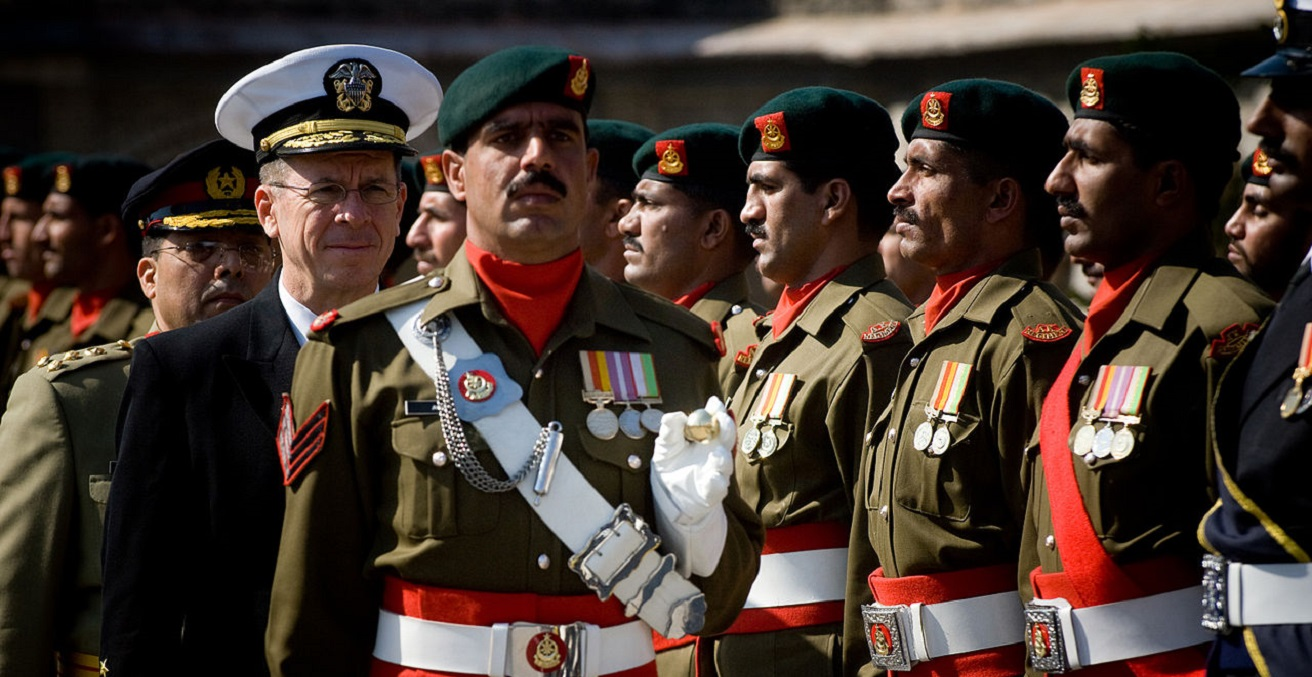Pakistani soldiers stand at an attention