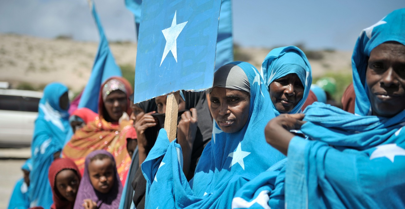 Somali women, wearing clothing with the Somali flag on it
