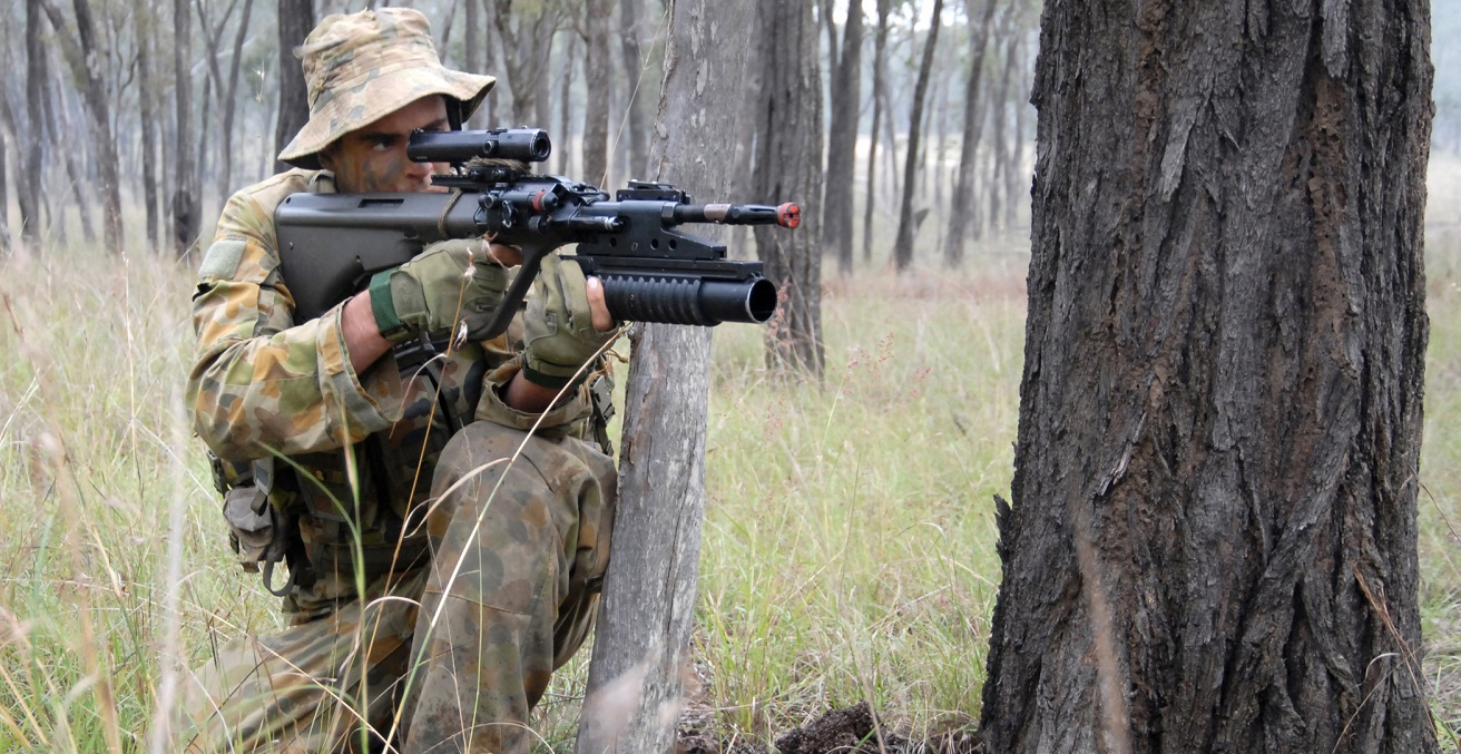 An Australian army soldier returns fire during an exercise.