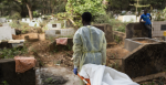 The Red Cross at the cemetery in Conakry, Guinea, in 2015 undertaking the safe and dignified burial of a 40-year-old woman who died from Ebola. Source: Martine Perret, UNMEER on Flickr