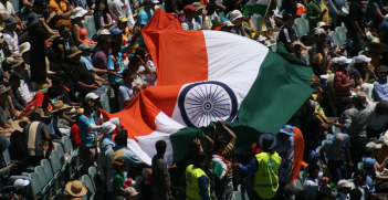 India cricket fans with an Indian flag. Source: Wikimedia Commons http://bit.ly/2MUzfP9