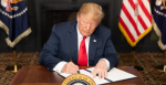 US President Donald Trump signs an executive order imposing sanctions on Iran in 2018.  Source: The White House