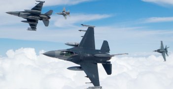 Royal Australian Air Force F/A-18 Hornets and United States Air Force F-16's break formation. Source: Flickr, Robert Sullivan http://bit.ly/32rcyWH