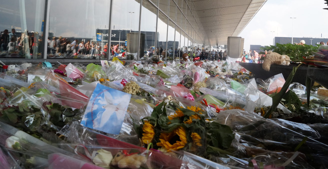 The sea of flowers at the airport for the victims of the disaster of Flight MH17. Source: Wikimedia Commons - Jurgen NL