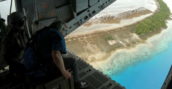 UN Secretary General Antonio Guterres surveys Tuvalu from an RAAF plane. Source: Australian Department of Defence