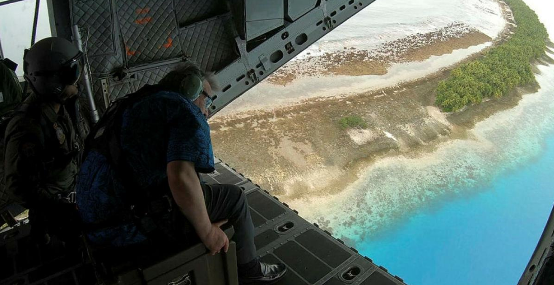 UN Secretary General Antonio Guterres surveys Tuvalu from an RAAF plane. Source: Australian Department of Defence