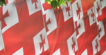Georgian Flags - Source: Wikimedia Commons.