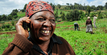 A woman in Kenya on her mobile phone. Photo: Wikimedia Commons - Neil Palmer
