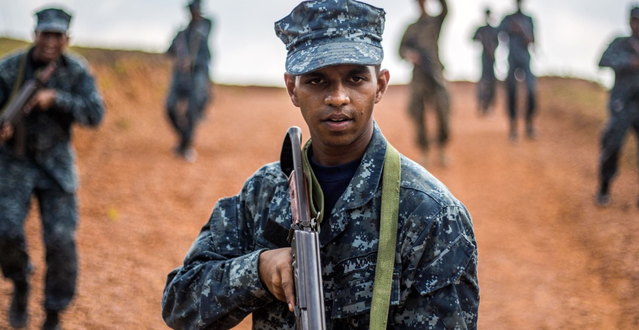 A Sri Lankan Marine takes point of his squad during the patrolling portion of a military tactics training and exchange, part of a theater security cooperation engagement at Welissara Naval Base, Sri Lanka, March 29, 2017. Photo by Cpl. Devan K. Gowans, US Marine Corps. Source: https://bit.ly/2OMNKlW