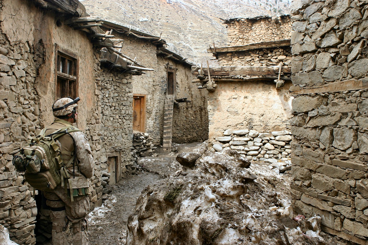 Marine in Ruined Afghan Village. Photo by Wiki Images. Source: https://bit.ly/2s4dxyl