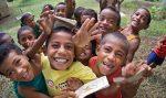 A group of school children at a village school in Vanua Levu, Fiji. Photo by Marc Anderson.