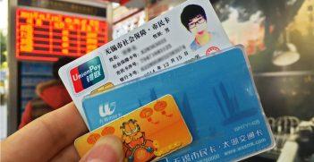 Chinese identification cards. Photo by Xiaosan Ji. Source: https://bit.ly/2QdeCMP