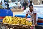 Man selling bananas. Photo by LauraDBusiness0. Source: https://bit.ly/2DZm0Wo