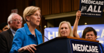 Sen. Elizabeth Warren (D-Mass.) speaks at the introduction of the Medicare for All Act of 2017 on Sept. 13, 2017 as Senator Bernie Sanders looks on.  Source: Senate Democrats https://bit.ly/2PrCT21
