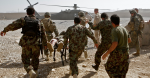 Shot in the leg during a patrol, medics carry an Afghan soldier to an awaiting US helicopter. Source: Al Jazeera English https://bit.ly/3arJd1i