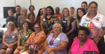 Participants, including the three authors, of the Indigenous Women's Health Yarning Circle (discussion gathering), held in Brisbane in March 2018 and facilitated by the National Aboriginal and Torres Strait Islander Women's Alliance, Women on Country, and the University of Queensland (Photo: supplied by Nina Hall).