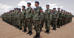 Newly arrived engineers from China serving with the United Nations-African Union Mission in Darfur (UNAMID) stand to attention after arriving in Nyala, South Darfur. Source: Stuart Price https://bit.ly/2vHorw6