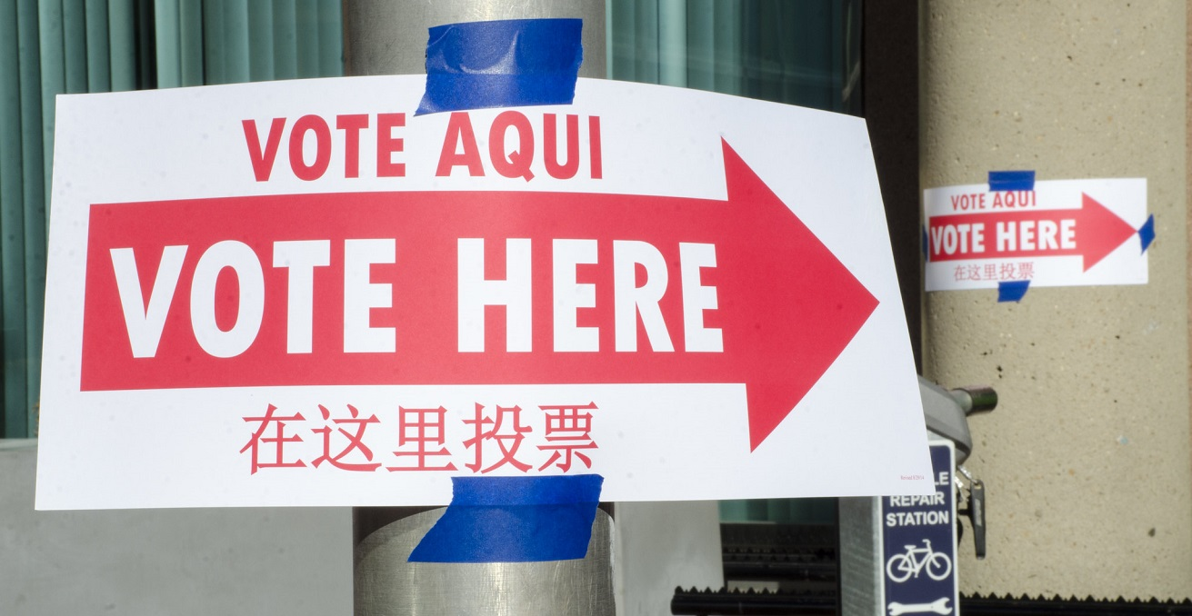 Voting signs in Spanish, English, and Chinese show the way to the polling station.  Source: Tim Brown https://bit.ly/34H2wSR