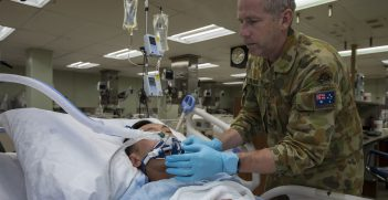 Australian Army Reserve Nursing Officer Captain William Cater assesses an intensive care patient onboard hospital ship USNS Mercy (T-AH 19), during Pacific Partnership 2016. Pacific Partnership is an annual deployment of forces designed to strengthen maritime and humanitarian partnerships during disaster relief operations, while providing humanitarian, medical, dental and engineering assistance to nations of the Pacific. Source: Australian Defence Force photo by Cpl. David Cotton https://bit.ly/35d6vXj