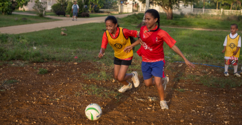 Children living in the Fasi Moe Afi area of Nukuʻalofa, Tonga take part in a Just Play soccer program, an initiative funded by AusAID. Source: Connor Ashleigh for AusAID https://bit.ly/39KIMys